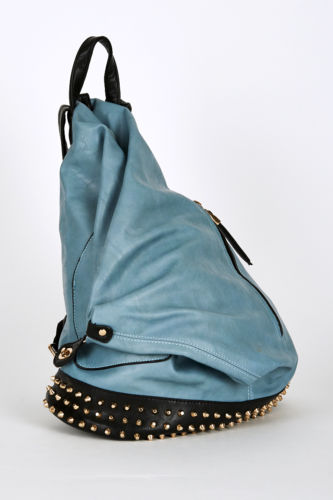 studded side clasp leatherette backpack in light petrol